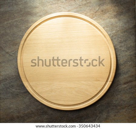 pizza cutting board at table - stock photo