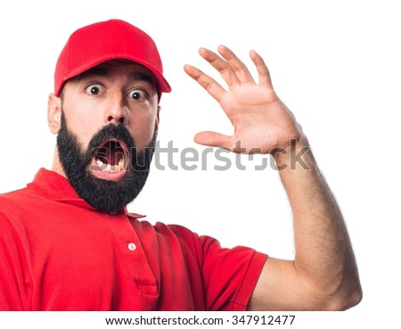 Pizza delivery man doing surprise gesture