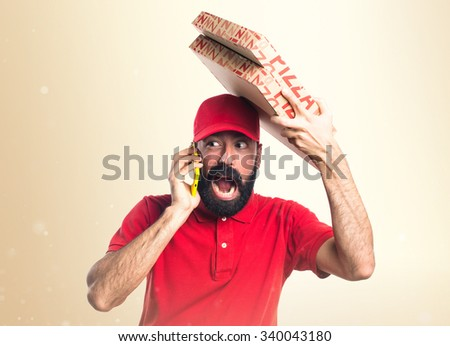Pizza delivery man talking to mobile