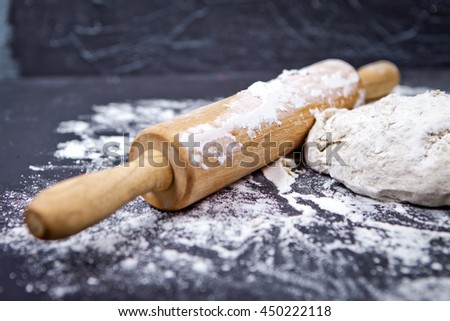 Pizza dough on black wooden background - stock photo