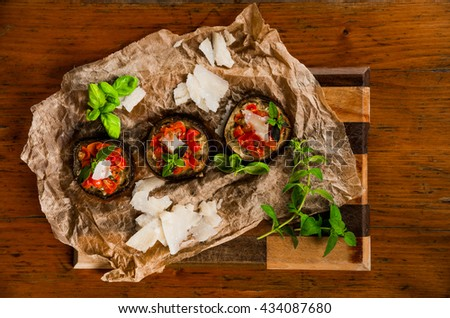 pizza eggplant with tomatoes, basil and oregano and parmesan cheese  - stock photo