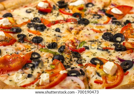 Pizza ham with cheese, tomatoes and pepper. Close-up. Background