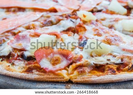 Pizza Hawaiian with ham mushroom pineapple and Salmon pizza in restaurant. - stock photo