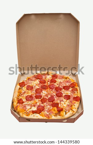 Pizza in a box. Tasty pizza with pepperoni sausage in cardboard box - stock photo