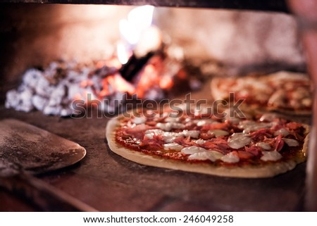 Pizza in baking - stock photo