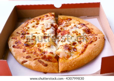 Pizza in the cardboard box close up photo - stock photo