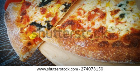 Pizza in the oven - stock photo