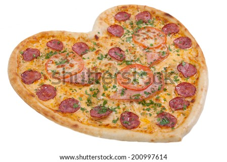 pizza in the shape of a heart with tomatoes, ham and salami sprinkling of fresh herbs on the Chroma key