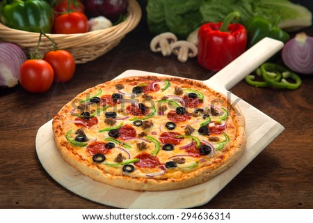 Pizza made fresh authentic recipe ingredients homemade home cooked healthy organic toppings - stock photo