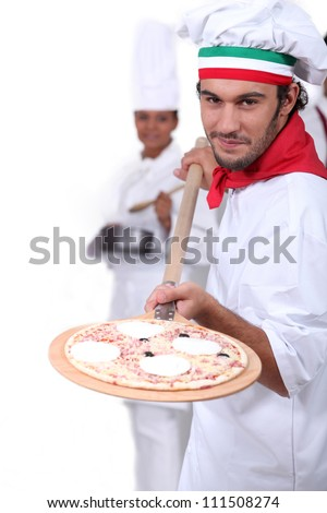 Pizza maker displaying his pizza - stock photo