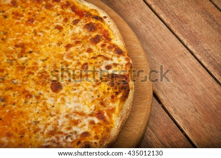 Pizza Margarita with wooden background