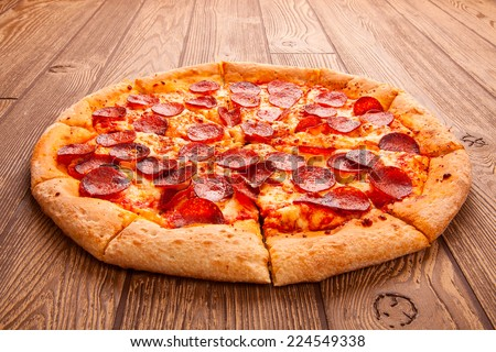 Pizza on a wooden table - stock photo
