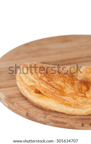 Pizza pastry half on the wooden board.