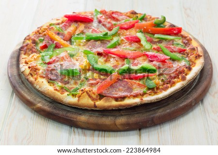 Pizza Pepperoni on wood table
