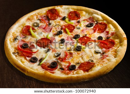 Pizza quattro stagioni with salami, green and red bell pepper, olives and ham - isolated Collection of dozens of various pizza (30 items) - stock photo