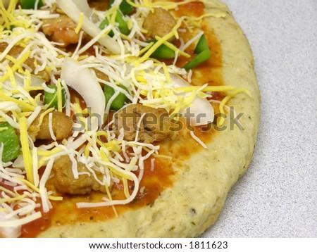 Pizza ready for for the oven. - stock photo