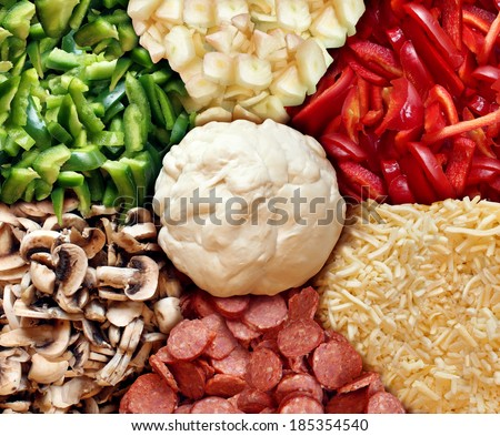 Pizza recipe and ingredients food concept  with a flower pattern of dough chopped mushrooms with mozzarella as cooking elements for a homemade cuisine kids activity or restaurant dinner preparation. - stock photo