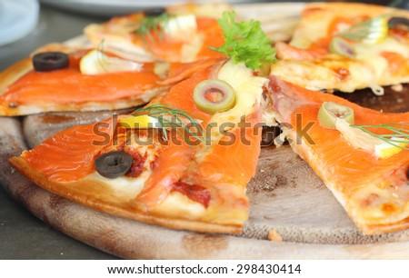 Pizza salmon pieces. - stock photo