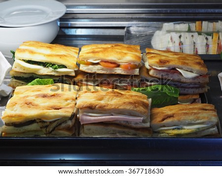 Pizza sandwiches in a bar - stock photo