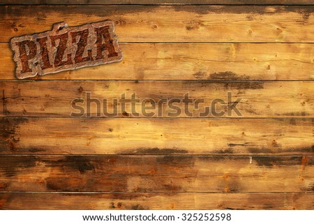pizza signboard nailed to a wooden wall - stock photo