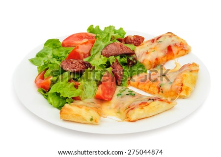 Pizza slices with melted cheese and fresh vegetables salad - stock photo
