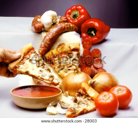 Pizza slices with raw vegtables - stock photo