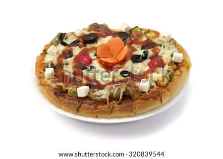 Pizza topped with tomato sauce, cheese, olive, chopped cabbage, cherry and carved carrot. - stock photo