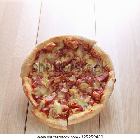 Pizza vegetarian with mushroom and pineapple on wood table - stock photo