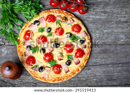 pizza with bacon, olives and tomato