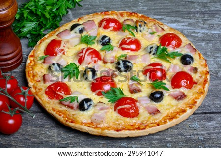 pizza with bacon, olives and tomatoes