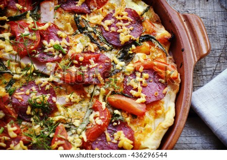 pizza with bacon, salami and vegetables