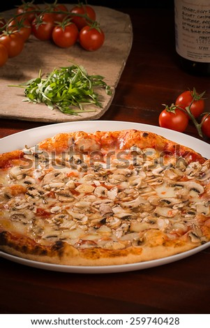 Pizza with cheese and mushrooms - stock photo