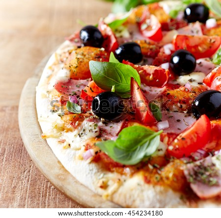 Pizza with Ham and Cherry and Cherry Tomatoes
