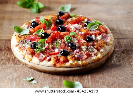 Pizza with Ham and Cherry and Cherry Tomatoes - stock photo
