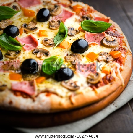 Pizza with Ham and Mushrooms - stock photo