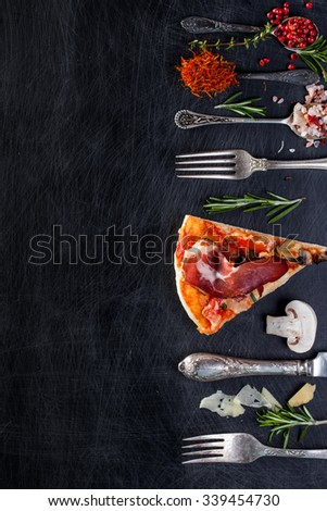 Pizza with Ham and Mushrooms on dark background - stock photo