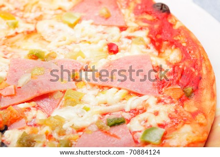 Pizza with ham and vegetables closeup