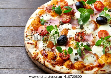 Pizza with Ham, Cherry Tomatoes and Mozzarella - stock photo