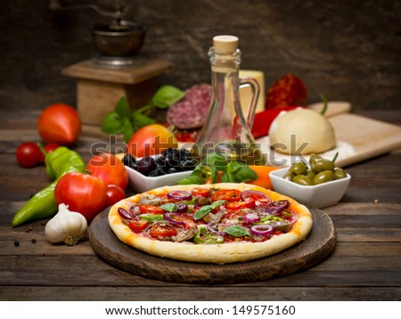 Pizza with ham, mushrooms and cheese - stock photo