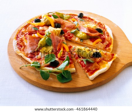Pizza with ham peppers and olives