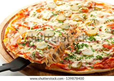 Pizza with Ham, Pickled Cucumber, Tomatoes and Mozzarella Cheese - stock photo