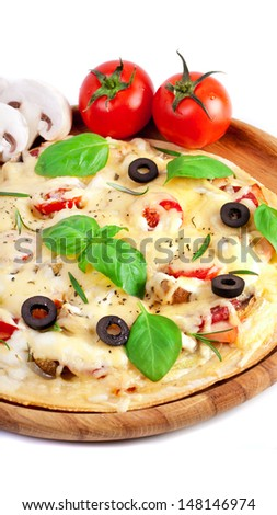 Pizza with ham, salami and olives