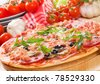 pizza with ham, salami and vegetables - stock photo