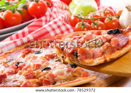pizza with ham, salami and vegetables
