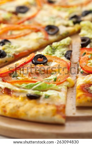 Pizza with Mozzarella, Sauce, Tomatoes and Salad Leaves - stock photo