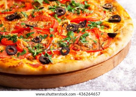 Pizza with olives, tomatoes and peperoni isolated on white