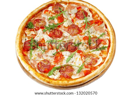 Pizza with pepperoni,ham, bavarian sausages  on wooden stand, isolated on white background. - stock photo