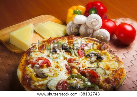 pizza with red tomato, mushrooms and cheese - stock photo