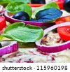 pizza with salami, cheese and fresh herbs - stock photo