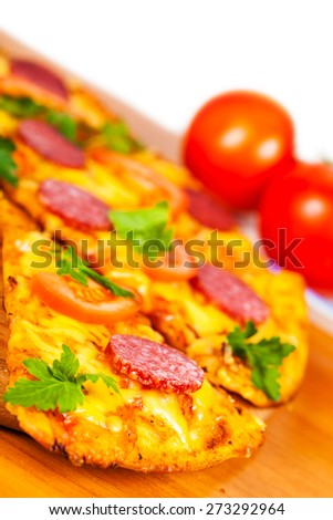 pizza with salami on background ripe tomato - stock photo